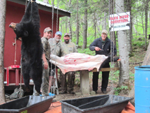 Jeremy, Dale and hunters cutting up bears