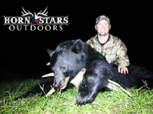 Chris from Horn Stars Outdoors tags another bear in New Brunswick