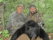 Barry and guide from taxis river outfitters show off their black bear