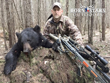 Cody, from Horn Stars Outdoors is successful bow hunting black bear